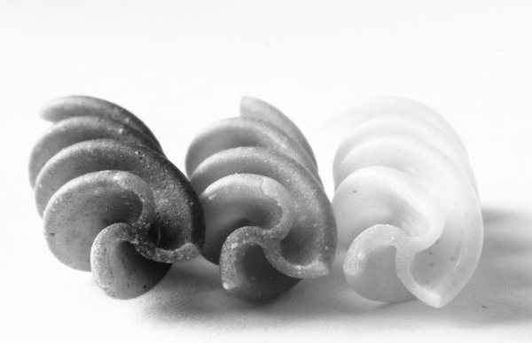 Fusilli pasta lying down, black, carbohydrate, closeup, dried, durum, food, fusilli, green, italian, lying, macaroni, pasta, raw, spiral, three, uncooked, wheat, white, photo